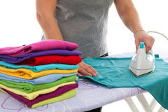 Housewife is doing the ironing Stock Images