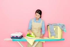 Housewife doing the ironing feel tired and sleepy Stock Photo