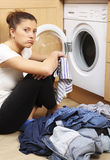 Housewife doing laundry Royalty Free Stock Image