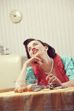 Housewife dreaming. Vintage portrait of a happy housewife in the kitchen Royalty Free Stock Images