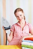 Housewife dreamy woman with iron engaged in domestic work Royalty Free Stock Photo