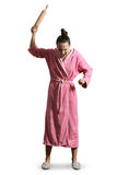 Housewife in dressing gown holding rolling pin Royalty Free Stock Image