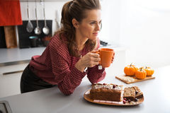 Housewife drinking tea with freshly pumpkin bread Royalty Free Stock Images