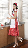 Housewife drying dishes in kitchen Royalty Free Stock Image