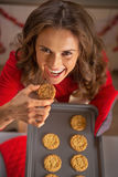 Housewife eating homemade christmas cookies Royalty Free Stock Photography