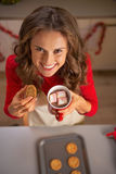 Housewife eating homemade christmas cookies Stock Image