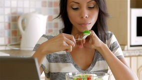 Housewife eating salad stock video