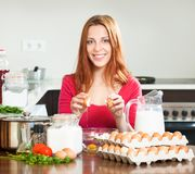 Housewife  with eggs in home kitchen Stock Photography
