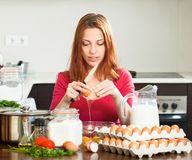 Housewife  with eggs in  kitchen Royalty Free Stock Photo