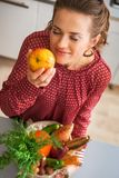 Housewife enjoying freshness of purchases from local Royalty Free Stock Images
