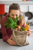 Housewife enjoying freshness of vegetables Stock Photo