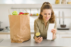 Housewife examines purchases after shopping Stock Photos