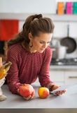 Housewife exploring checks after grocery shopping Royalty Free Stock Images