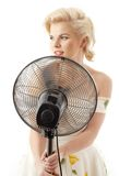 Housewife with fan playing pop star Royalty Free Stock Images