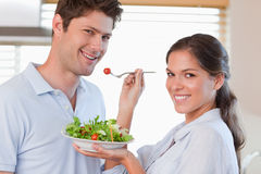 Housewife feeding her husband Stock Photo
