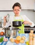 Housewife feeling bad smell from pan Royalty Free Stock Photos
