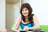 Housewife fills in  utility payments bills Stock Photos