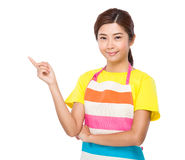 Housewife finger point up Royalty Free Stock Image