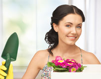 Housewife with flower in box and gardening trowel Royalty Free Stock Image