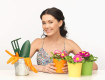 Housewife with flower in pot and gardening set Stock Photos