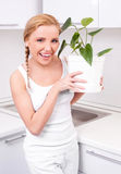 Housewife with flowers Royalty Free Stock Photography