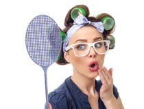 Housewife with fly swatter Stock Image