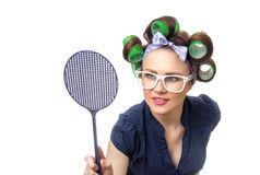 Housewife with fly swatter Royalty Free Stock Images
