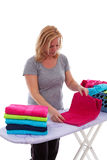 Housewife is folding towels Stock Image