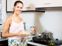 Housewife frying omelette Royalty Free Stock Photo