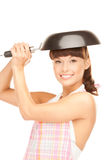 Housewife with frying pan Royalty Free Stock Images