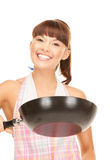 Housewife with frying pan Stock Photos