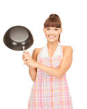 Housewife with frying pan Stock Image
