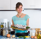 Housewife frying saltwater fish Royalty Free Stock Image