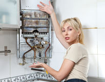 The housewife  and gas water heater Stock Image