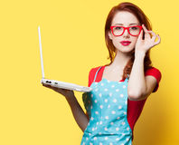 Housewife in glasses with computer Royalty Free Stock Image