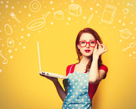 Housewife in glasses with computer Royalty Free Stock Photos