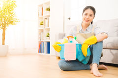 Housewife in gloves sitting on floor Stock Photography