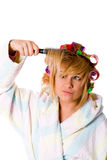 Housewife with hairbrush Royalty Free Stock Photos