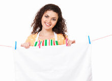 Housewife hanging clothes on the line Stock Images