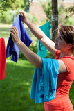 Housewife hanging the laundry Royalty Free Stock Photo