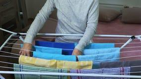 Housewife hangs towels on dryer stock footage