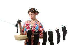 Housewife hangs up socks on  the clothesline Stock Photos