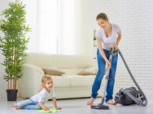 Housewife. Happy family cleans the room royalty free stock photos