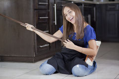 Housewife having fun with a broom Stock Photos