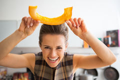 Housewife having fun time using cutting pumpkin Stock Images