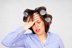 Housewife with headache Royalty Free Stock Photo