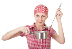 Housewife in headscarf with ladle and pan Royalty Free Stock Images