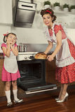 Housewife and her daughter baking bread Royalty Free Stock Photo