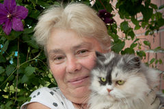 A housewife and her pet cat Royalty Free Stock Photo