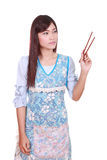 Housewife hold a chopsticks Royalty Free Stock Photography